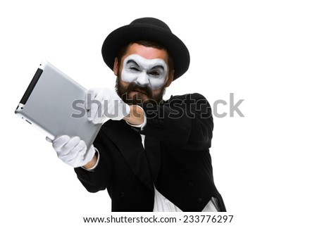 mime as a businessman throws computer in rage. Isolated on white background.  The concept of despair in business.