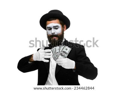 mime as businessman holding money isolated on a white background. concept  love of money and greed - stock photo