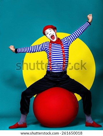 mime fooling around in front of camera on color  background - stock photo