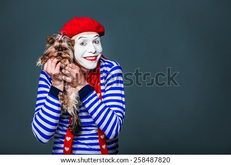 mime hugging her dog  - stock photo
