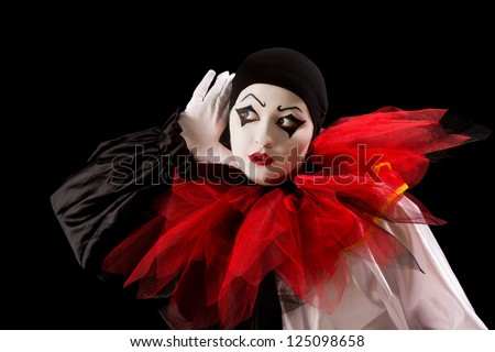 Mime Pierrot actor holding her hands as in listening - stock photo