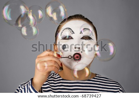 Mime portrait with bubbles on grey background