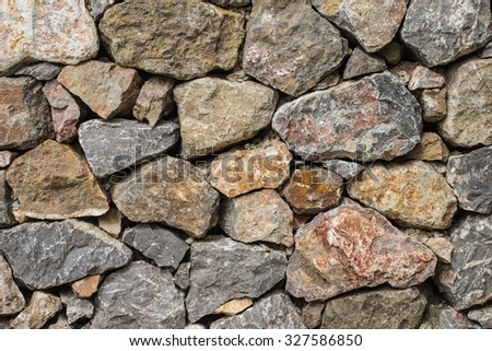 Mimic natural stone wall.Details of finishing works in construction. - stock photo