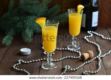 Mimosa cocktail with orange juice and champagne on Christmas background horizontal - stock photo