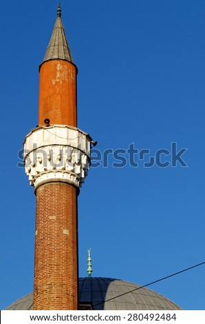 Minaret at Banya Bashi Mosque in Sofia, Bulgaria. The Mosque is a remnant of the Ottoman rule in Bulgaria and it is the biggest in the country. - stock photo