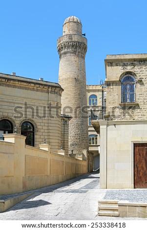 Minaret of Juma Mosque (Cume mescidi) in the Baku Old City, Azerbaijan - stock photo