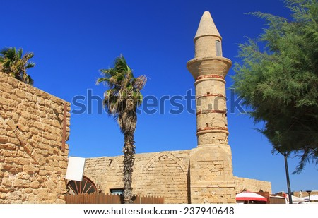 Minaret ruins in Caesarea Maritima National Park, a city and harbor built by Herod the Great about 25-13 BC. The archaeological ruins are on the Mediterranean coast of Israel. - stock photo