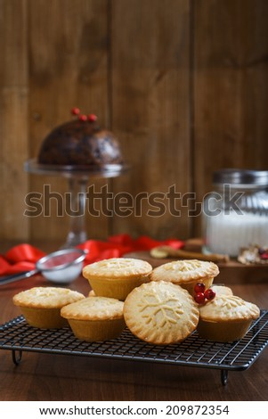 Mince pies on cooling rack for Christmas - stock photo