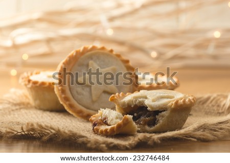 Mince pies with out of focus Christmas lights - stock photo