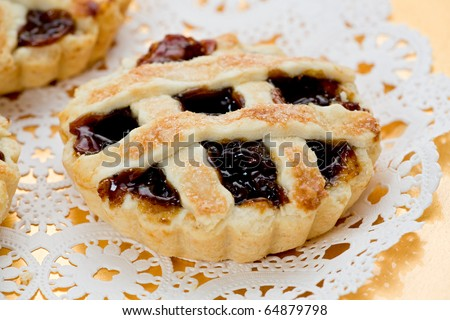 Mince tarts on gold plate. - stock photo