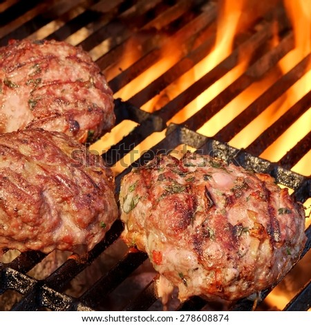 Minced Beef Pork Mutton Burgers On The Hot BBQ Grill Background Closeup. Good Snack For Outdoor Summer Barbecue Party Or Picnic