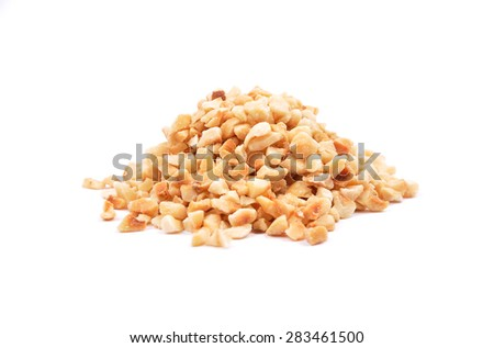 Minced hazelnuts on white - stock photo