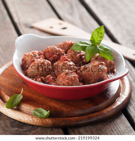 Minced meat ball in tomato saucel, selective focus  - stock photo