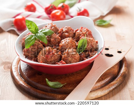 Minced meat ball in tomato saucel, selective focus