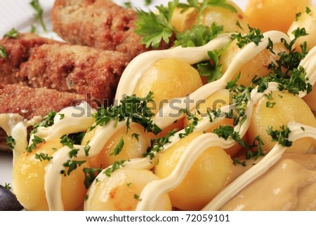 Minced meat kebabs and potatoes