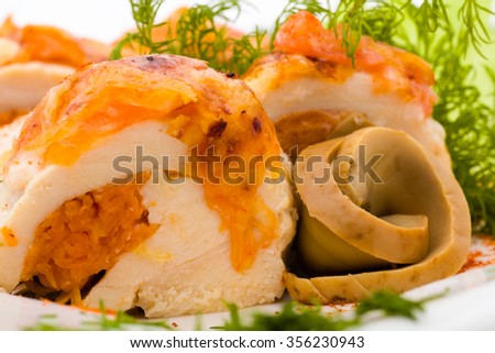 Minced meat loaf roll with mushrooms, isolated on white background.
