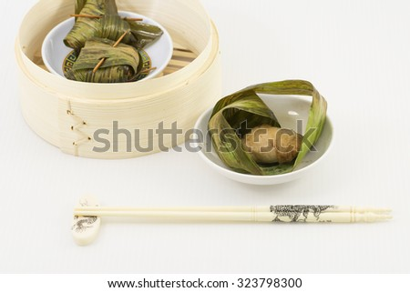 Minced meat mix with fish paste wrap with pandan lead. A dim sum style Chinese cuisine prepared as small bite-size portion of food traditionally served in small steamer basket or on small plate. - stock photo