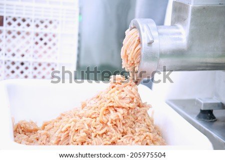 Mincer machine and fresh chopped meat - stock photo