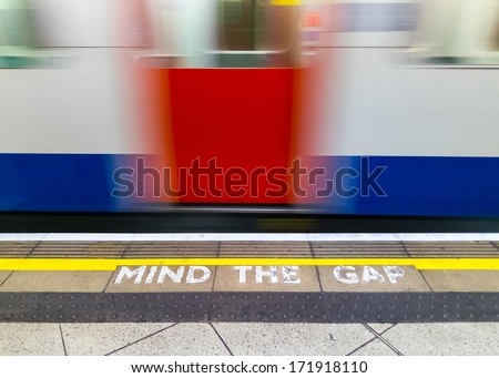 Mind the Gap warning in the London underground, England, Uk - stock photo
