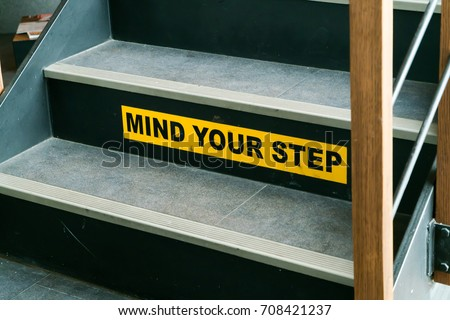 Mind your step sign at staircase