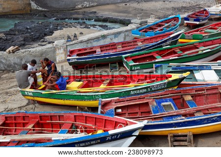 MINDELO, CAPE VERDE - DECEMBER 12: Fishermen sitting on fishing boats on Santo Antao island, Cape Verde (Cabo Verde), Africa
