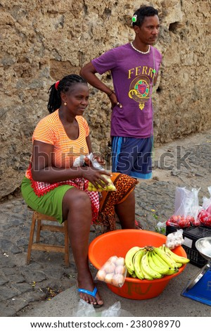 MINDELO, CAPE VERDE - DECEMBER 12: Market women selling fruits, vegetables and fish in Mindelo, Sao Vicente island, Cape Verde (Cabo Verde), Africa - stock photo