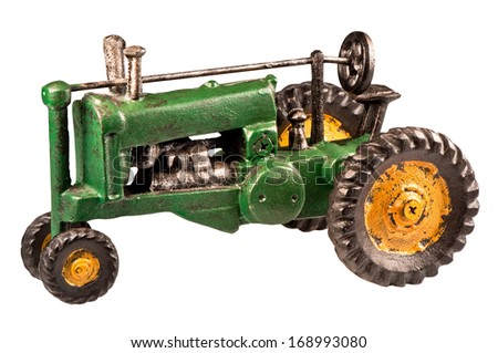 MINDEMOYA, ONTARIO, CANADA-May 12, 2009: Photo of an antique miniature replica tractor in John Deere colors, isolated on white. - stock photo