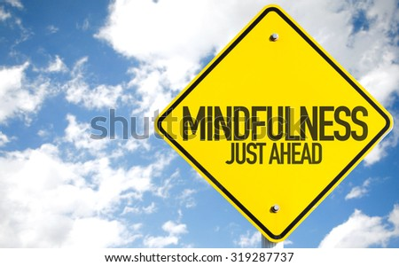 Mindfulness Just Ahead sign with sky background