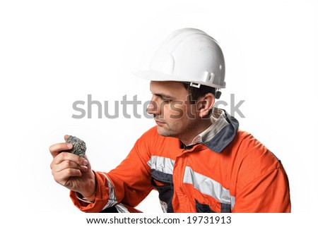 Mine engineer checking mineral isolated on white stock photo