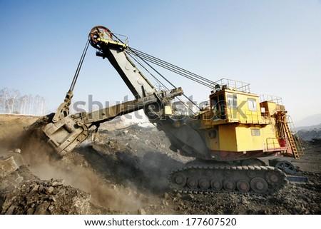 Mine excavator at work  - stock photo