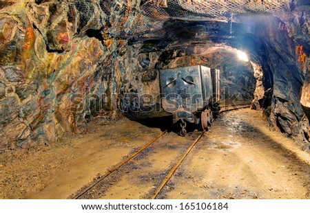 Mine with truck and railroad - stock photo