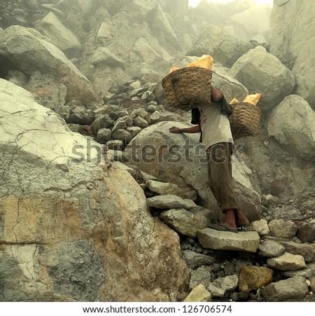 mine worker in sulfur mine - stock photo