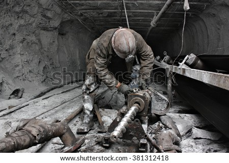 miner in a mine - stock photo