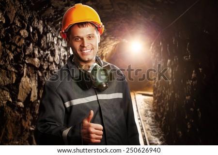Miner in the mine - stock photo
