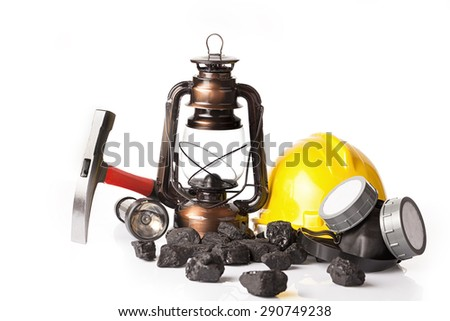 Miner`s tools with protective helmet, ear muffs,pickaxe and oil lantern - stock photo
