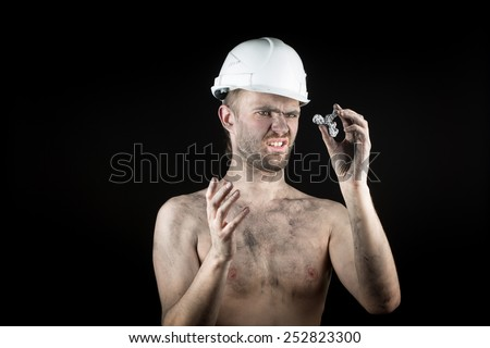 miner shows a silver nugget  - stock photo