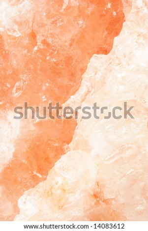 Mineral background of salt rock lamp - stock photo