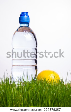 Mineral water bottle and lemon