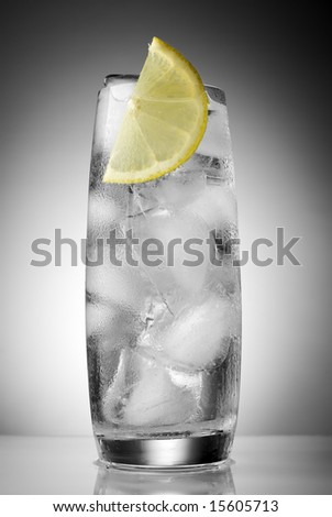 mineral water with ice and lemon close up - stock photo