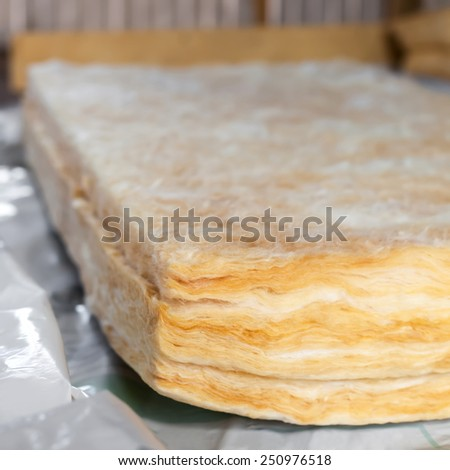 Mineral wool is ready to thermally insulating house attic - stock photo