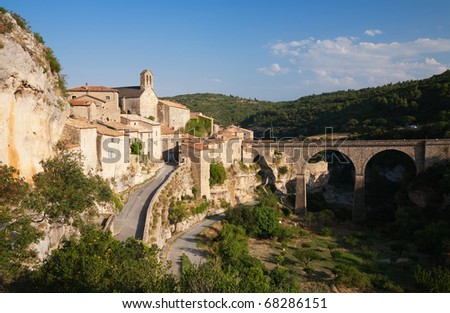 Minerve village and bridge in France in summer sun - stock photo