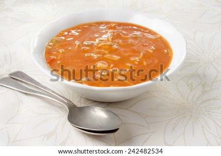 minestrone soup with carrot, potato and noodle in a bowl