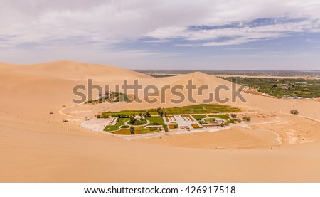 Mingsha Shan desert and Crescent Lake(Moon Lake) in Dunhuang, Gansu Province, Western China. - stock photo