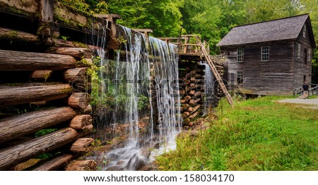 Mingus Mill at the smoky mountains national park with lush spring green and flowing water - stock photo