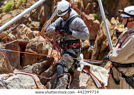 Mingus Mountain, Arizona, USA - May 6, 2016 Jerome, Arizona firefighters working together with Exxon Rescue Squad practicing a rescue drill in Mingus Mountain on the side of the cliff - stock photo
