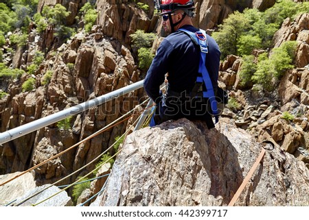 Mingus Mountain, Arizona, USA - May 6, 2016 Jerome, Arizona firefighters working together with Exxon Rescue Squad practicing a rescue drill in Mingus Mountain on the side of the cliff