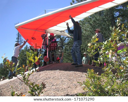 Mingus Mountain, AZ - September 25, 2004:  Hang glider on launch getting ready to fly off Mingus Mountain near Jerome, AZ.