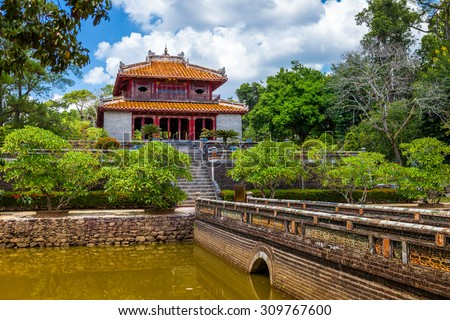Minh Lau pavilion and Trung Dao bridge at Minh Mang Emperor Tomb in Hue, Vietnam - stock photo