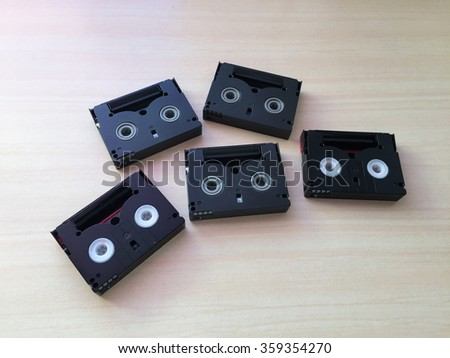 Mini and old VDO Tape. Cassette tape on white wood background - stock photo