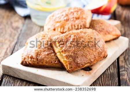 Mini apple cinnamon strudel  on a wooden desk, perfect food for picnic lunch with the kids - stock photo